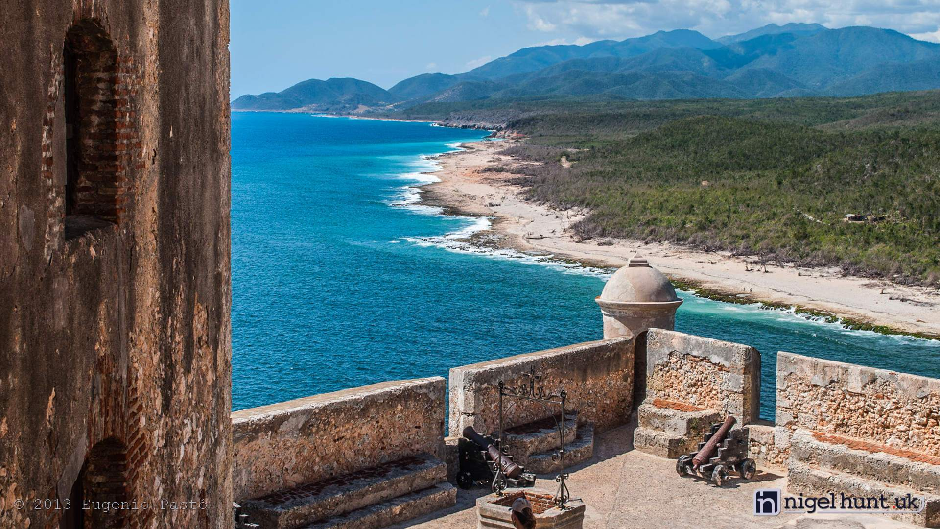 Morro Castle of Santiago de Cuba and view on the Sierra Maestra mountain